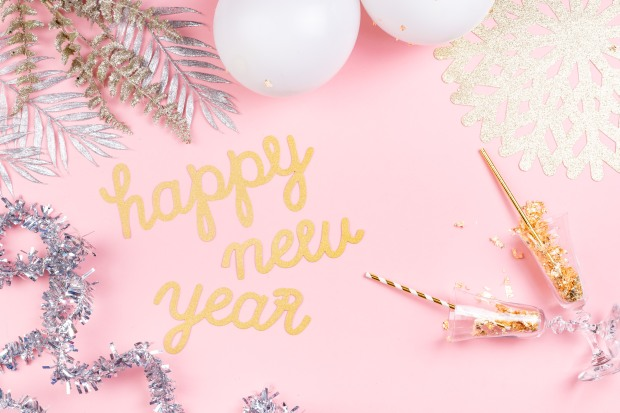 kaboompics_New Years Eve party decorations on pink background.jpg